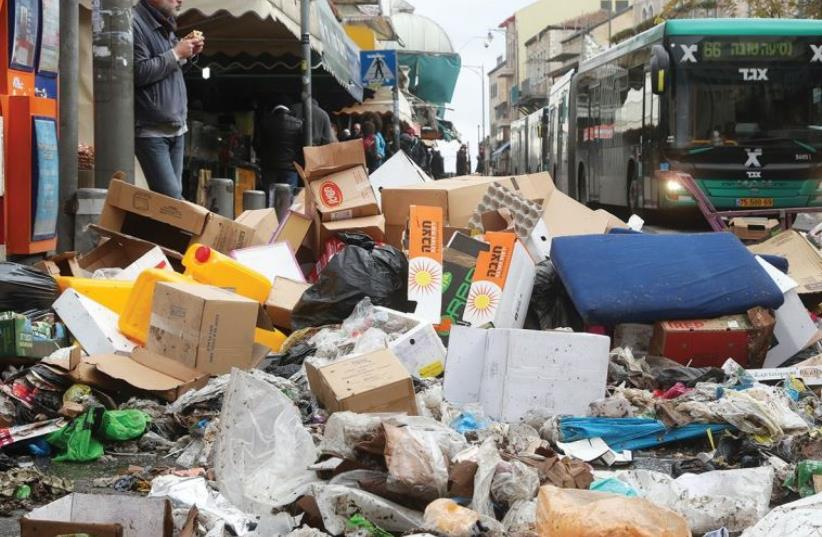 GARBAGE PILES UP on Agrippas Street just outside the Mahaneh Yehuda Market in the capital yesterday. (photo credit: MARC ISRAEL SELLEM/THE JERUSALEM POST)