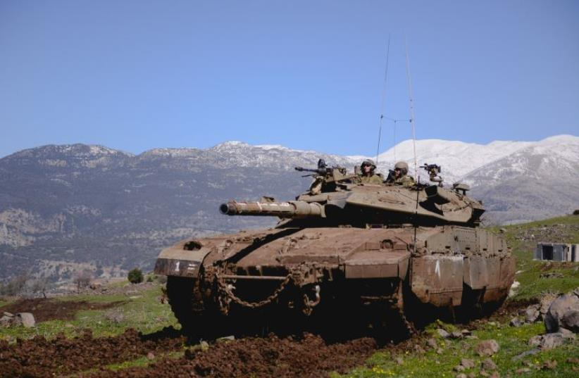 IDF Armored Corps soldiers train on the Golan Heights (photo credit: IDF SPOKESPERSON'S UNIT)