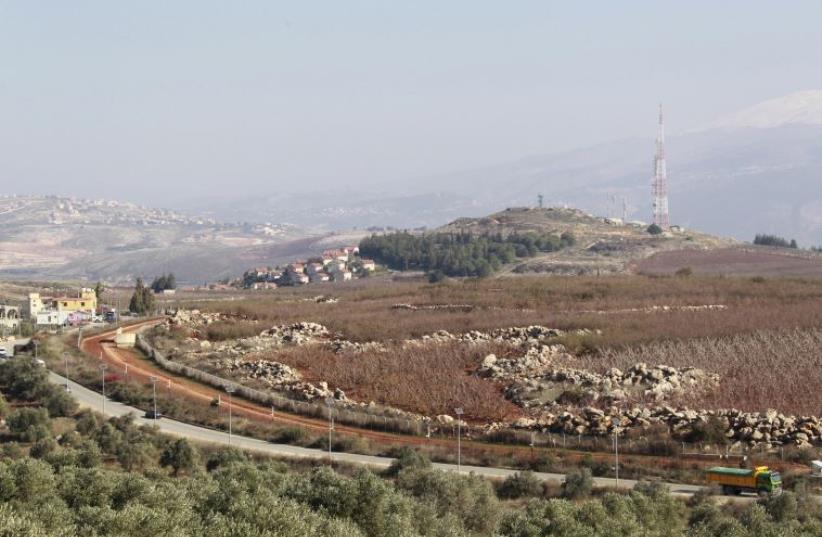 A general view shows the Lebanese-Israeli border as seen from Kfar Kila village, southern Lebanon December 21, 2015 (photo credit: REUTERS)