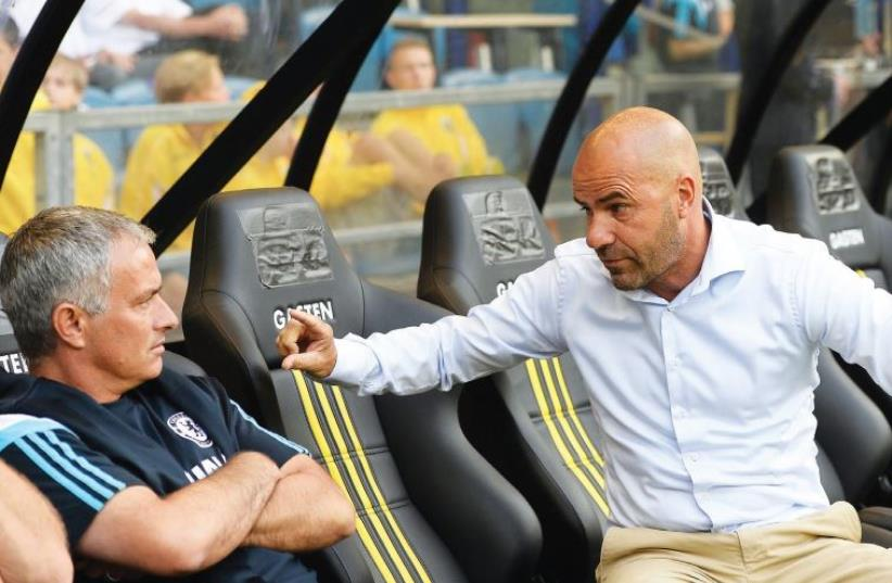The Peter Bosz era (right, talking with Jose Mourinho) began at Maccabi Tel Aviv yesterday after the 52-year-old Dutch native was appointed as the yellow-and-blue's new head coach. (photo credit: REUTERS)