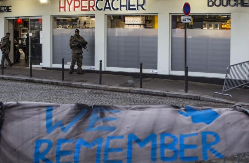 A French soldier patrols outside the Hypercacher kosher supermarket in Paris (photo credit: REUTERS)