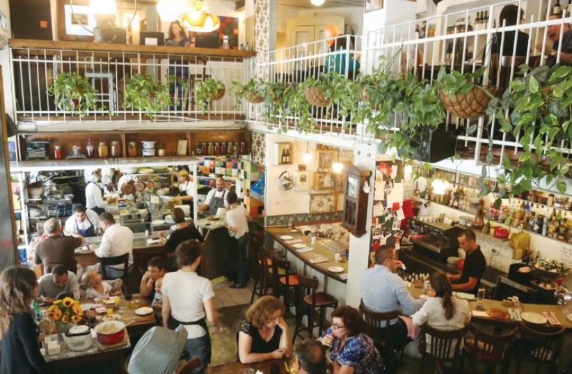 Patrons dine at a Mahaneh Yehuda restaurant in Jerusalem (photo credit: MARC ISRAEL SELLEM/THE JERUSALEM POST)