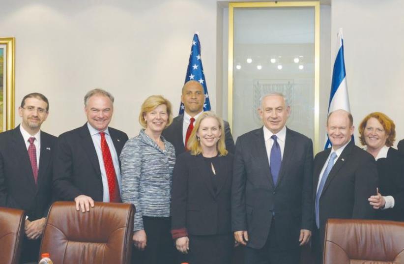 Prime Minister Benjamin Netanyahu and US Ambassador Dan Shapiro (left) pose with US Democratic senators yesterday. (photo credit: CHAIM TZACH/GPO)