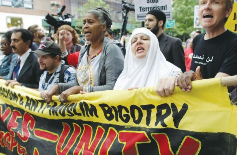 Protesters march in the Rally Against War, Racism and Islamophobia held on September 11, 2011, on the 10th anniversary of the 9/11 attack on the World Trade Center (photo credit: REUTERS)