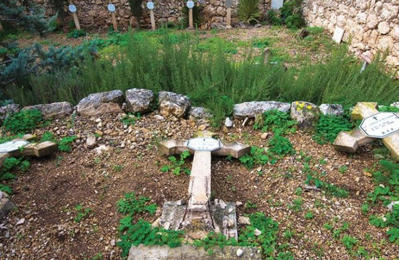 THESE CRUCIFORM TOMBSTONES were found knocked over at the Beit Jamal monastery, the result of one of several attacks against Christian sites in the Beit Shemesh area over the years. (photo credit: LATIN PATRIARCHATE OF JERUSALEM)