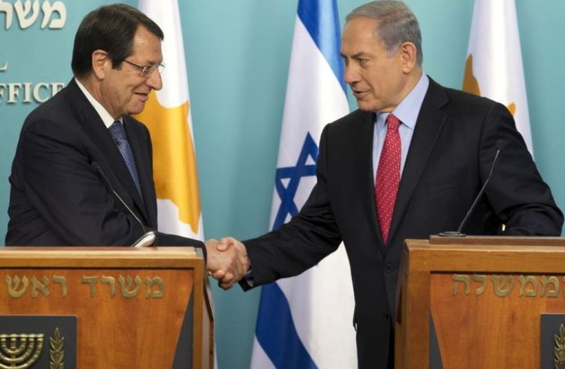 Cyprus President Nicos Anastasiades (L) and Prime Minister Benjamin Netanyahu  (photo credit: REUTERS)