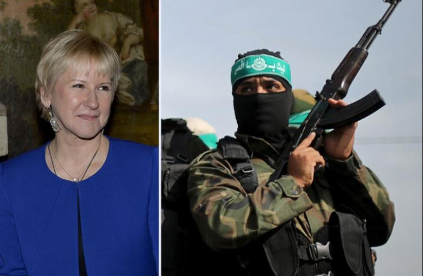 Margot Wallstrom and a Hamas militant (photo credit: REUTERS)