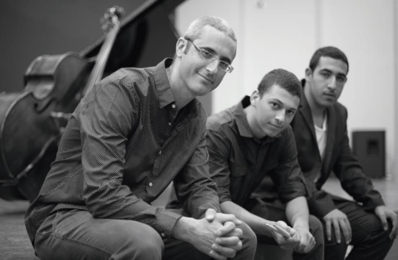 local bass player Tal Gamlieli (left) seen here with the rest of his trio. (photo credit: LUISA BURCATT SALOMON)