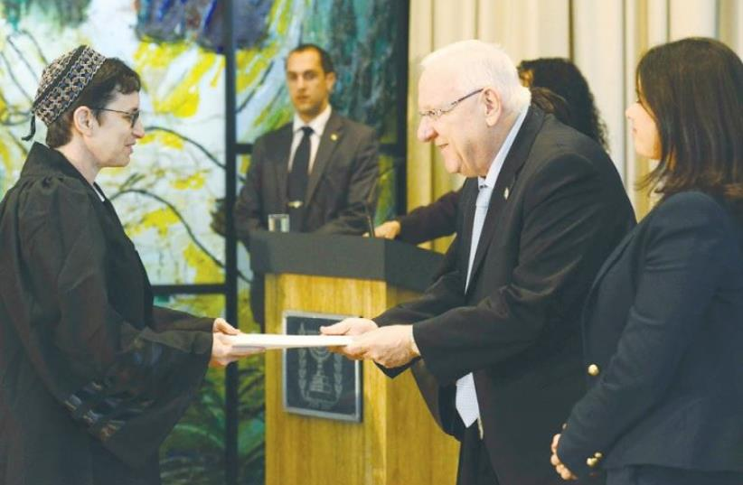 PRESIDENT REUVEN RIVLIN officiates at the swearing-in of 21 newly appointed judges and court registrars at his residence (photo credit: GPO)