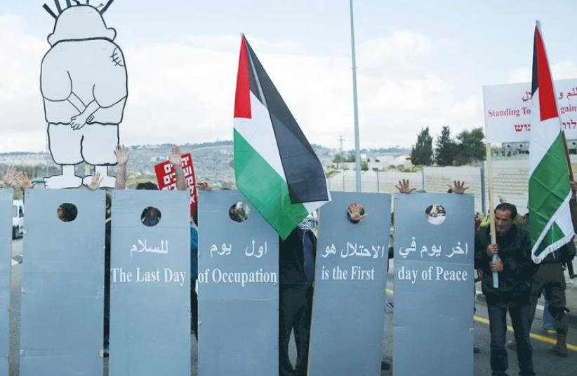 LEFT-WING Israelis and Palestinians demonstrate for a better future for both peoples near Jerusalem on Friday. The placards read: The last day of occupation is the first day of peace. (photo credit: REUTERS)