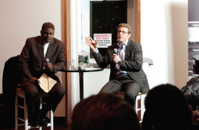 RABBI MARK WILDES and Imam Benjamin Bilal (left) give a joint lecture at an interfaith Manhattan Jewish Experience gathering in New York (photo credit: Courtesy)