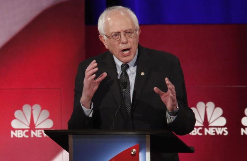 Democratic US presidential candidate and US Senator Bernie Sanders speaks at the NBC News - YouTube Democratic presidential candidates debate (photo credit: REUTERS)