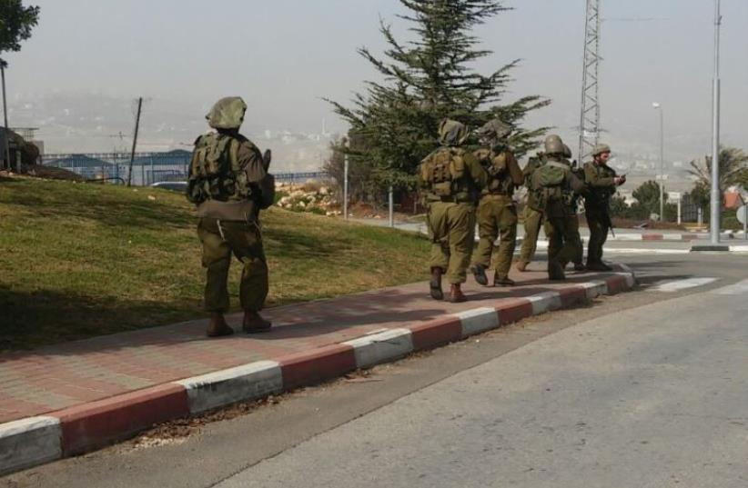 IDF forces conduct search after a Palestinian assailant stabbed an Israeli woman in Tekoa, January 18, 2016 (photo credit: Courtesy)