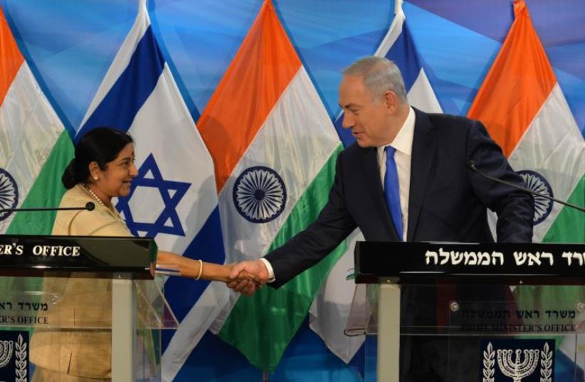 Indian External Affairs Minister Sushma Swaraj with Prime Minister Benjamin Netanyahu  (photo credit: KOBI GIDEON/GPO)