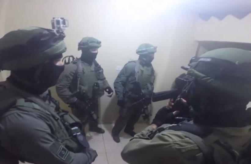 IDF and Shin Bet raid home of Otniel terrorist (photo credit: IDF SPOKESMAN'S UNIT)