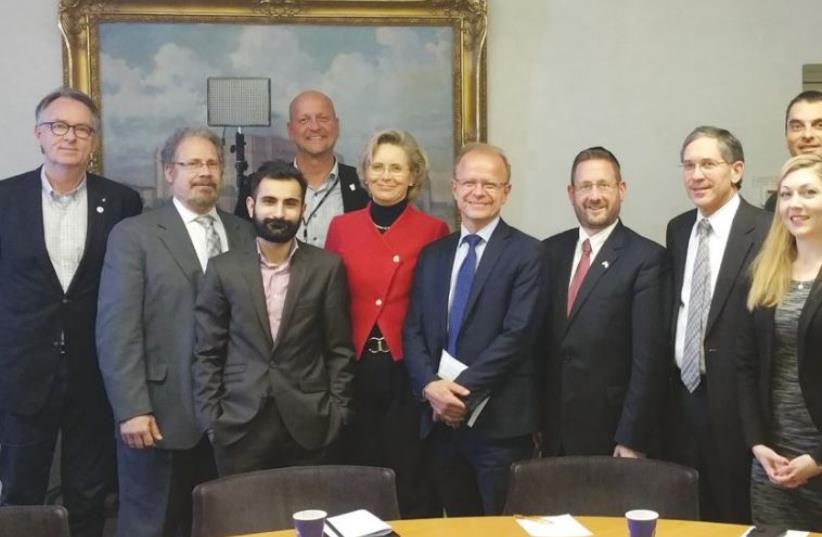 SWEDISH PARLIAMENTARIAN Margareta Cederfeldt (fifth from left) poses with, to her right, fellow MP Mikael Oscarsson, WZO director of public diplomacy Dov Lipman, Palestinian Media Watch's Itamar Marcus and other opposition lawmakers yesterday in Stockholm (photo credit: Courtesy)