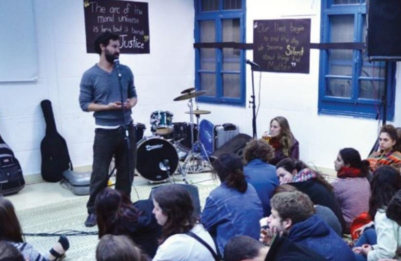 LECTURERS AND participants commemorate the life of Martin Luther King at the BINA Center for Jewish Identity and Hebrew Culture in Tel Aviv on Sunday. (photo credit: Courtesy)