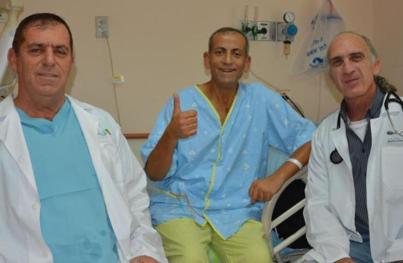 Prof. Aravot (left) and Dr. Ben-Gal (right) with recipient of the Heart Mate 3 (photo credit: Courtesy)