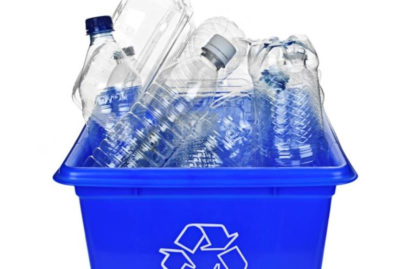 Recycling box filled with clear plastic containers (illustrative) (photo credit: INGIMAGE)