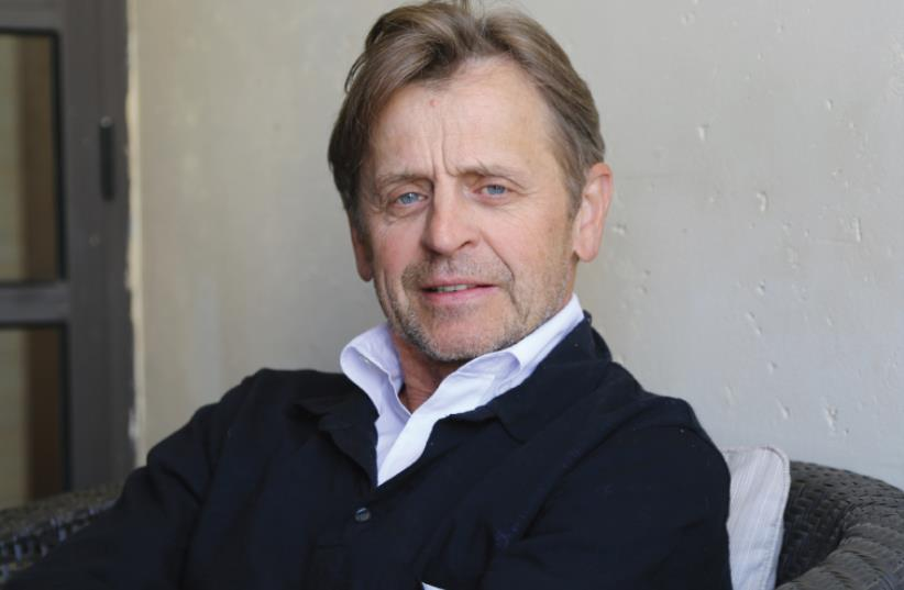 'I MISS the extraordinary pleasure of the working body. Of going into the studio and sweating, drinking and sweating again. But I don't have the right to miss dance because I keep dancing,' says Mikhail Baryshnikov, pictured here in Tel Aviv (photo credit: OFER BESSUDO)