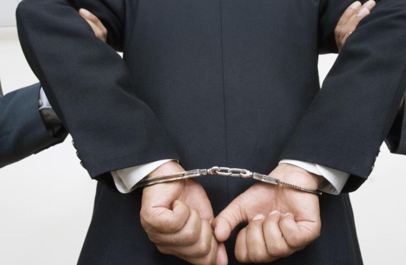 Man handcuffed (photo credit: INGIMAGE)