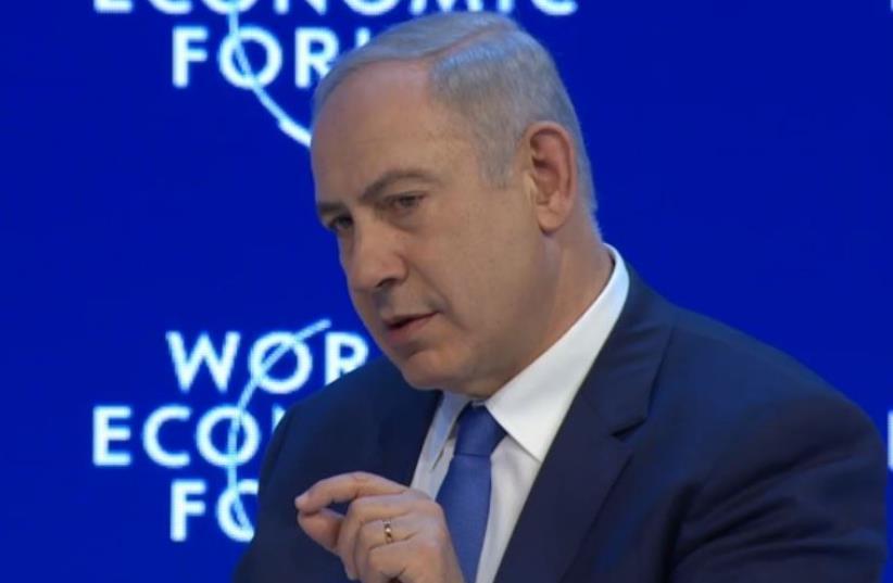 Netanyahu speaks with CNN's Fareed Zakaria in Davos (photo credit: screenshot)
