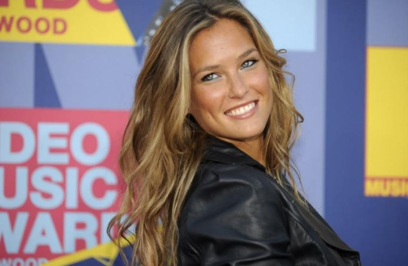 Model Bar Refaeli poses as she arrives at the MTV Video Music Awards in Los Angeles (photo credit: REUTERS)