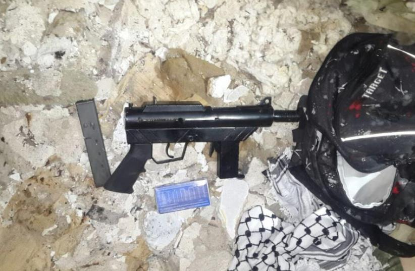 Weapons used by Palestinian terror cell that attacked IDF soldiers (photo credit: SHIN BET)