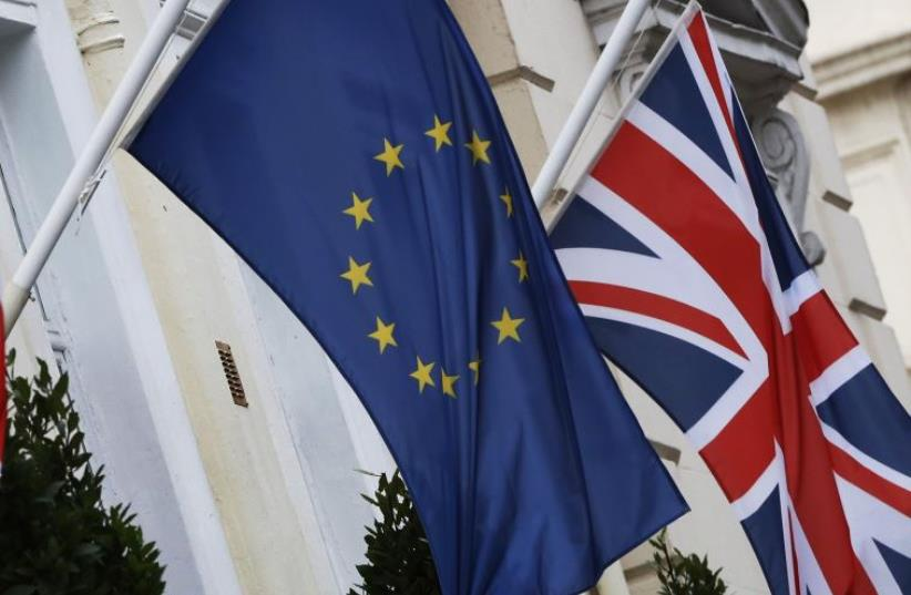 European Union and Union flags fly outside a hotel in London, Britain (photo credit: REUTERS)