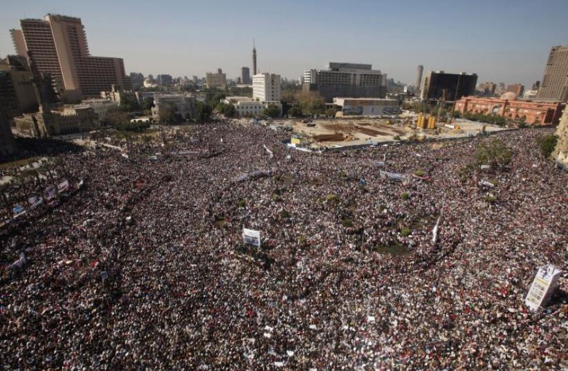 Opposition supporters attend Friday prayer in Tahrir Square in Cairo February 11, 2011 (photo credit: REUTERS)