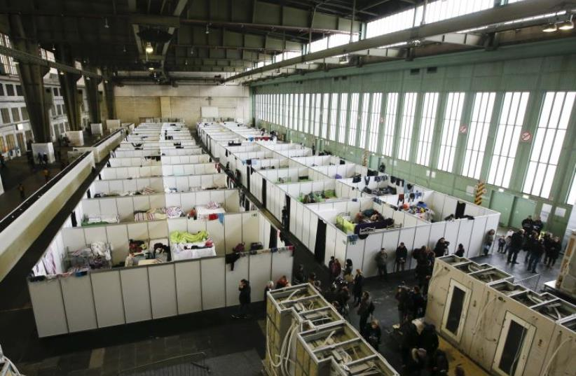 A general view of a shelter for migrants inside a hangar of the former Tempelhof airport in Berlin (photo credit: REUTERS)