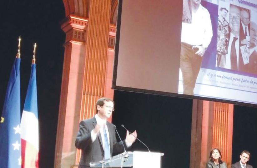 OPPOSITION LEADER Isaac Herzog speaks last night in Paris during commemorations marking 20 years since the assassination of Yitzhak Rabin. (photo credit: RINA BASSIST)