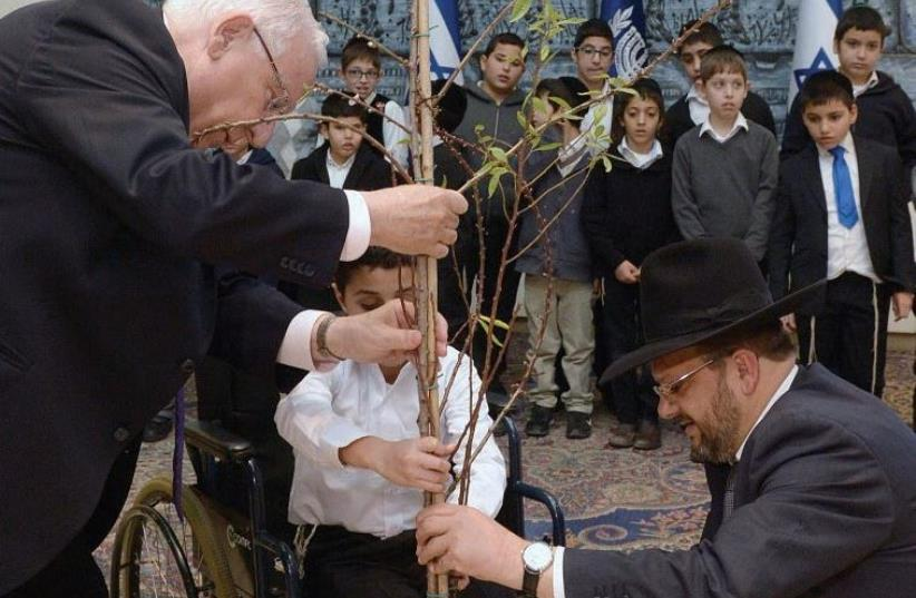 PRESIDENT REUVEN RIVLIN hosts special needs children on Tu Bishvat at his official residence. (photo credit: Mark Neiman/GPO)