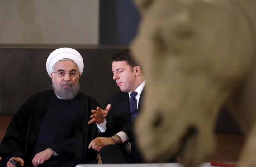 ran President Hassan Rouhani (L) talks with Italian Prime Minister Matteo Renzi at the Campidoglio palace in Rome, Italy, January 25, 2016 (photo credit: REUTERS)