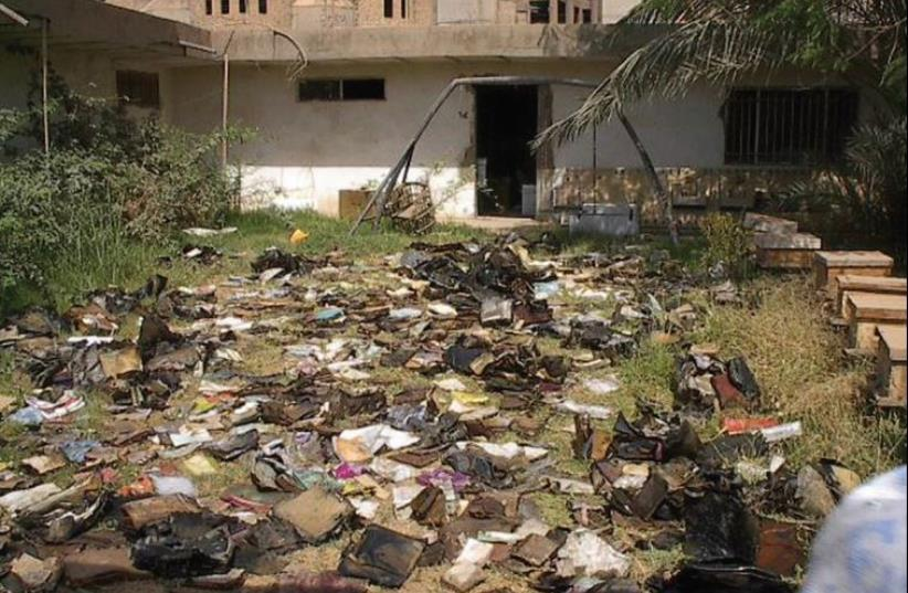 Materials strewn outside the Mukhabarat, Saddam Hussein's intelligence and secret police hub (photo credit: US NATIONAL ARCHIVES AND RECORDS ADMINISTRATION)