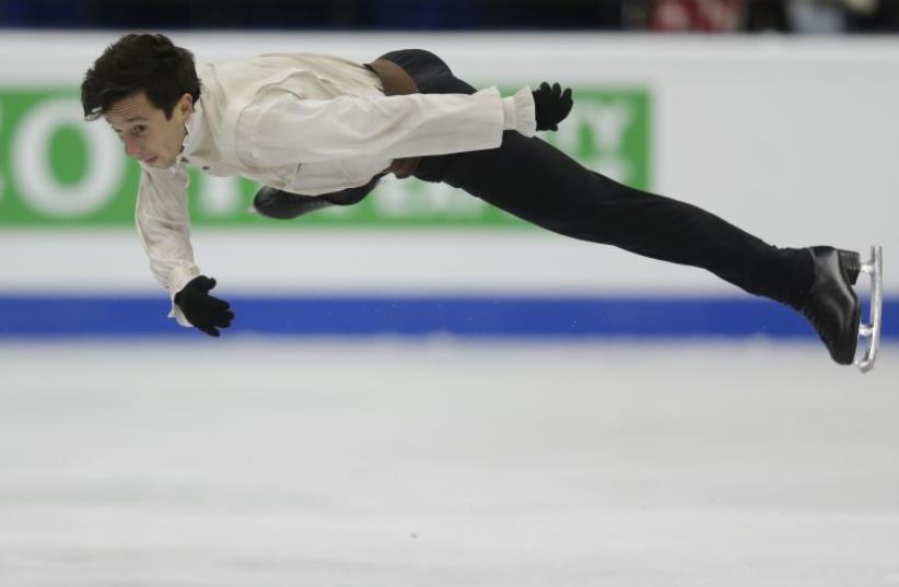 Israel's Alexei Bychenko operforms during the men's free program at the ISU European Figure Skating Championship in Bratislava, Slovakia, January 28, 2016 (photo credit: REUTERS)