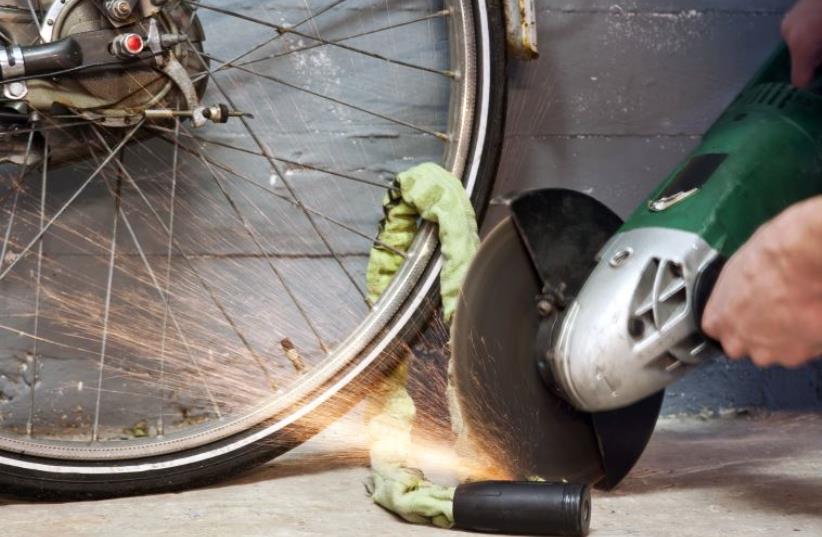 Bike thief  (photo credit: INGIMAGE)