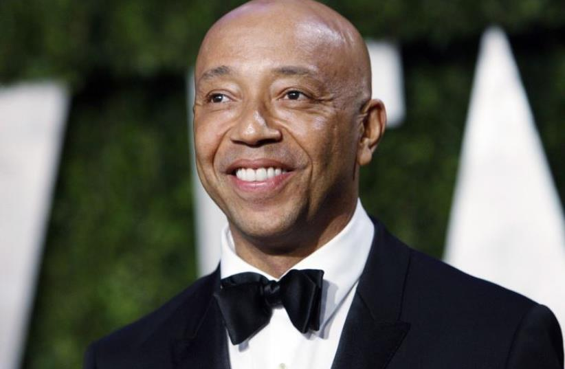 Def Jam co-founder Russell Simmons arrives at the 2010 Vanity Fair Oscar party (photo credit: REUTERS/DANNY MOLOSHOK)