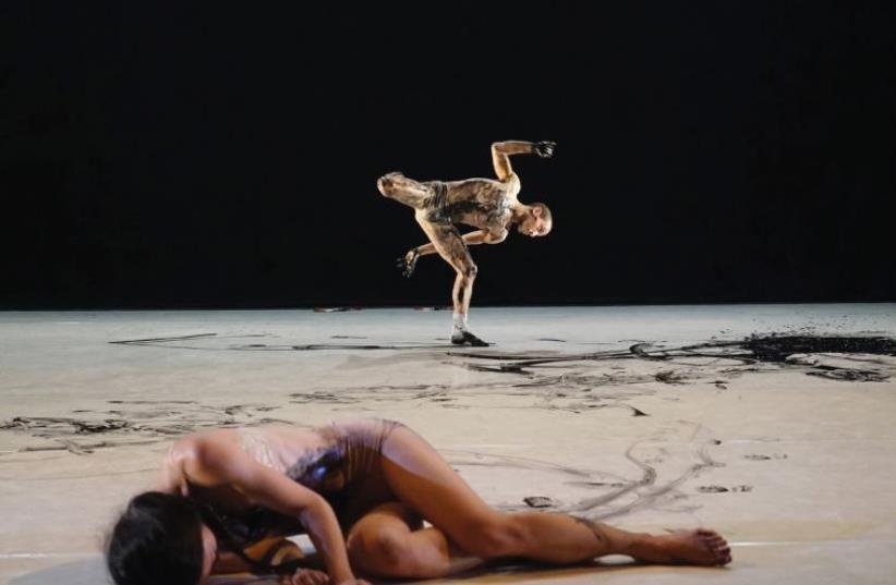 ISRAELI DANCER Shahar Biniamini performs with Japanese-born dancer Eri Nakamura in 'Kulukulupa.' (photo credit: GADI DAGON)