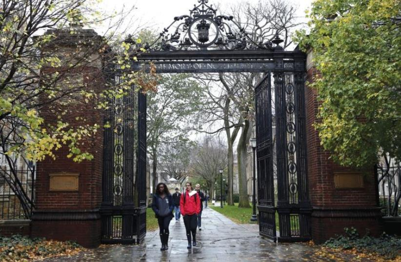 STUDENTS WALK on the campus of a university in Connecticut (photo credit: REUTERS)