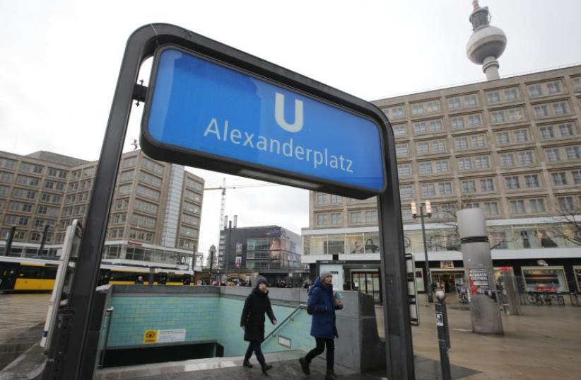 People leave the subway station at Alexanderplatz in Berlin, Germany February 4, 2016 (photo credit: REUTERS)