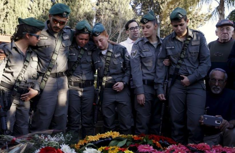 Comrades of Border Policewoman Hadar Cohen mourn during her funeral in Yehud (photo credit: REUTERS)