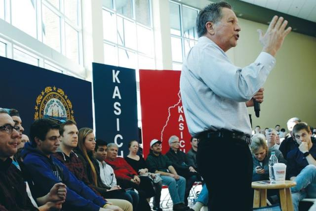 US REPUBLICAN PRESIDENTIAL candidate Ohio Gov. John Kasich speaks to voters in Nashua, New Hampshire (photo credit: REUTERS)