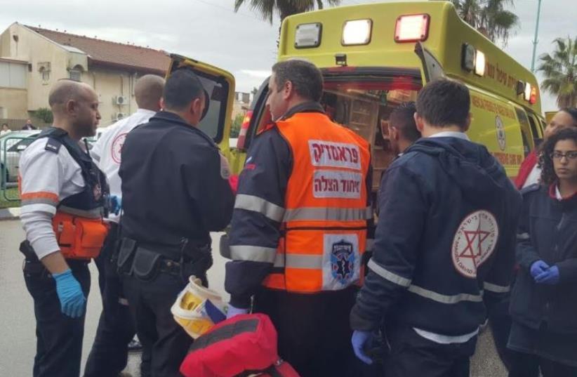 Paramedics at the scene of a stabbing in Ramle,  (photo credit: UNITED HATZALAH)