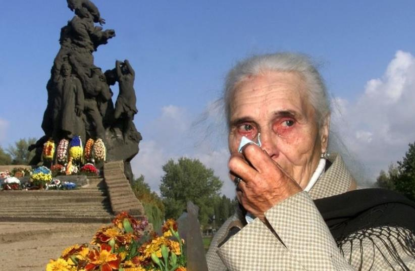 Ludmila Pynikh, 77, grieves during a mourning ceremony at Babi Yar in Kiev [File] (photo credit: REUTERS)