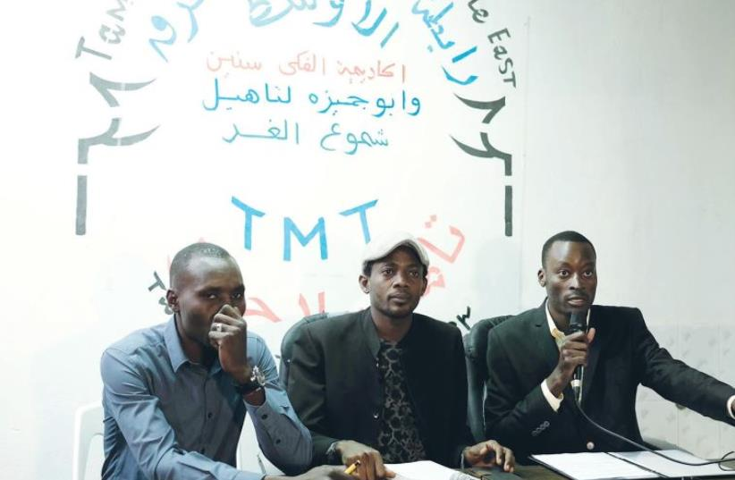 REPRESENTATIVES OF the Sudanese community speak to reporters in south Tel Aviv yesterday. (photo credit: FLASH90)