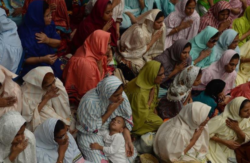Indian Muslim women at a mosque in Mumbai [Illustrative] (photo credit: PUNIT PARANJPE/AFP)