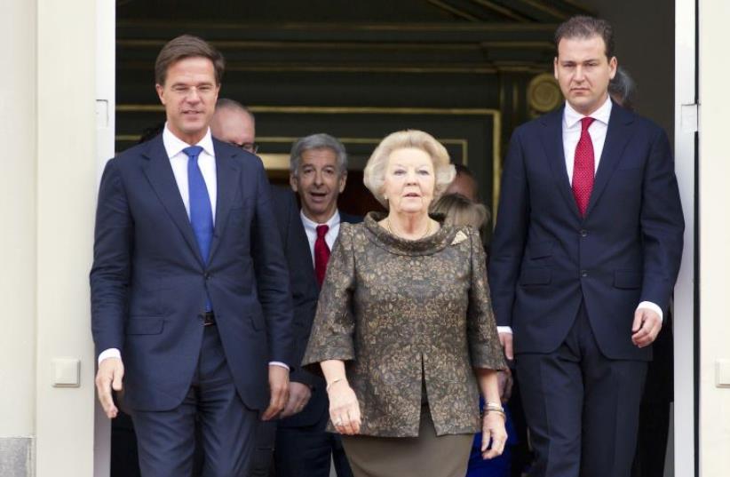 Queen Beatrix of the Netherlands (C), Prime Minister Mark Rutte (L) and Deputy Prime Minister Lodewijk Asscher. (photo credit: MICHAEL KOOREN / REUTERS)