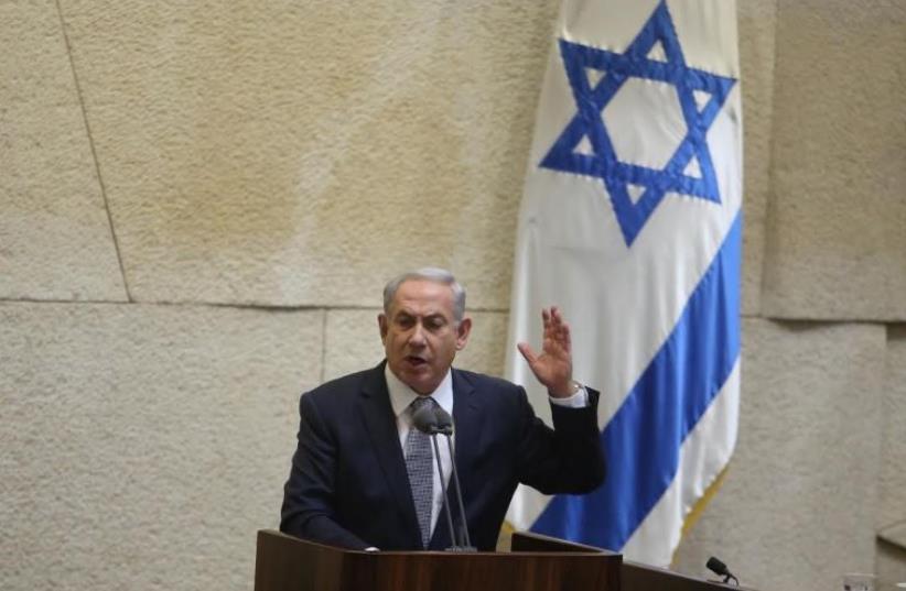 Prime Minister Benjamin Netanyahu addresses the Knesset in Jerusalem (photo credit: MARC ISRAEL SELLEM)
