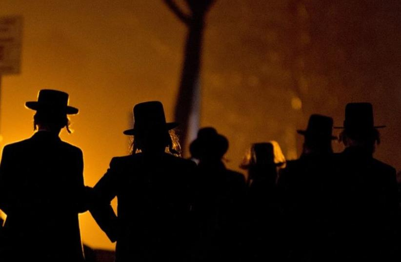 Hassidic Jews arrive at a mass gathering in Brooklyn (photo credit: REUTERS)
